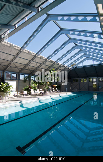 Indoor swimming pool public stock photos indoor swimming for Indoor pool with retractable roof