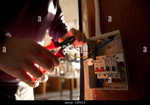 fusebox stock photos fusebox stock images alamy an electrician trimming electrical wires before fixing to a mains fuse box uk stock