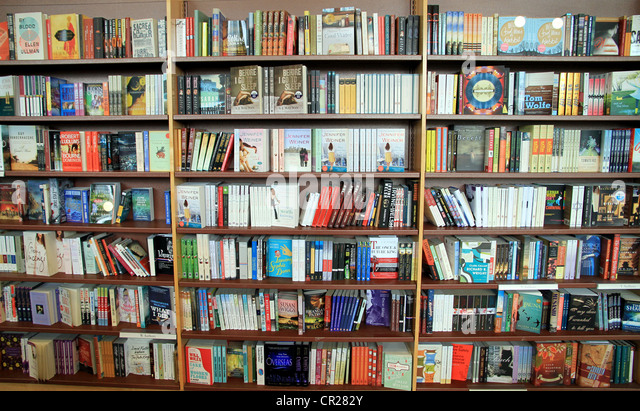 A bookstore bookshelf filled with books in Toronto. - Stock Image