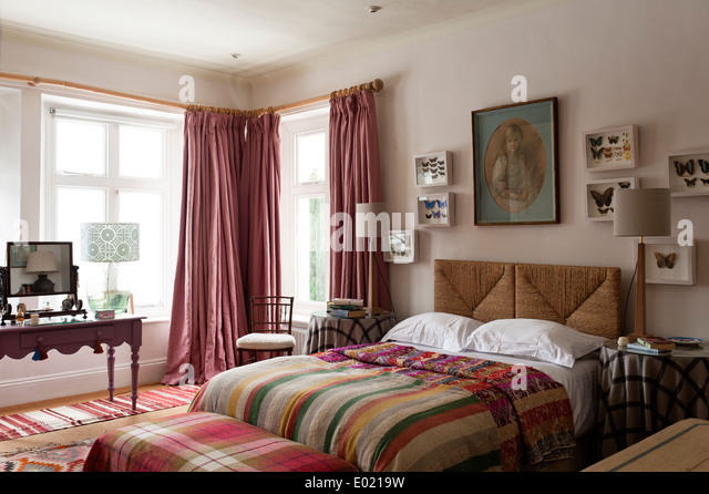 Pink Nicole Fabre Floor Length Curtains In Bedroom With Wicker Headboard,  Framed Butterfly Art And