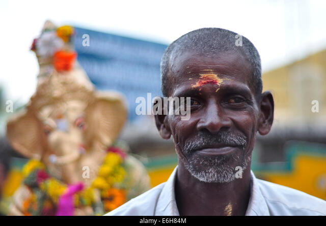 Indian man celebrates Ganesh Chaturthi leading the Ganesh sculptures parade in Rameswaram, India. - - indian-man-celebrates-ganesh-chaturthi-leading-the-ganesh-sculptures-e6h84m