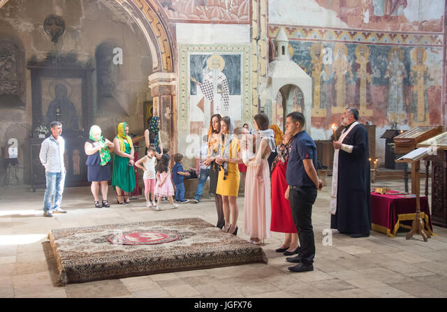 Christening ceremony in Cathedral of the Nativity of the Virgin, Gelati Monastery, Kutaisi, Imereti Province (Mkhare), - Stock Image