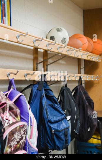 Childrenu0027s Backpacks Hanging On Hooks In Classroom   Stock Image