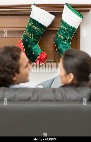 Young Couple Christmas Stocking Hanging Stock Photos & Young ...