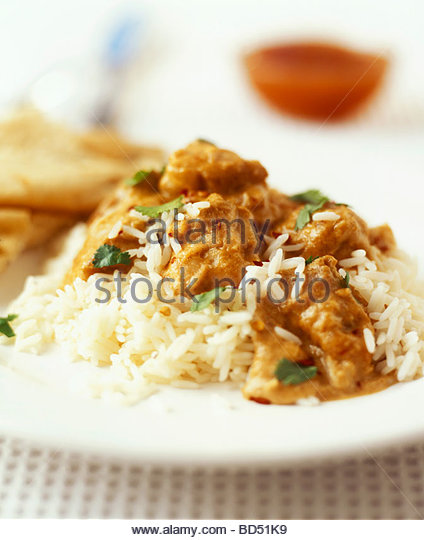 Chicken korma (chicken in almond curry sauce) with rice - Stock Image