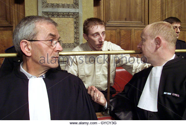 Frenchman Patrick Dils (C) speaks witrh his lawyers Bertrand Becker (L ...