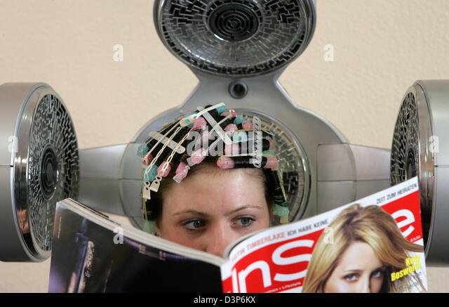 Stefanie Schwanke gets a permanent wave in a hairdresser's shop in ...