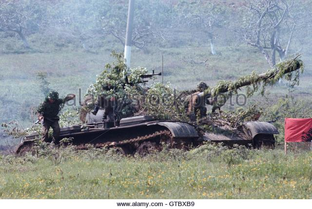 Hobo Tanks of the World, Unite! An-albanian-soldier-jumps-from-a-russian-type-chinese-built-t-54-tank-gtbxb9