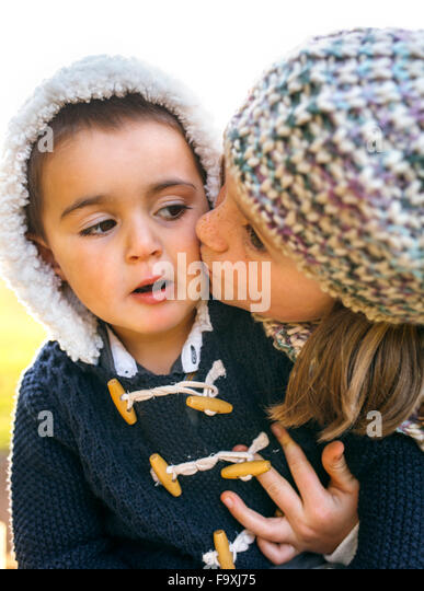 Little boy and girl kissing stock photos little boy and girl girl kissing little boy altavistaventures Images
