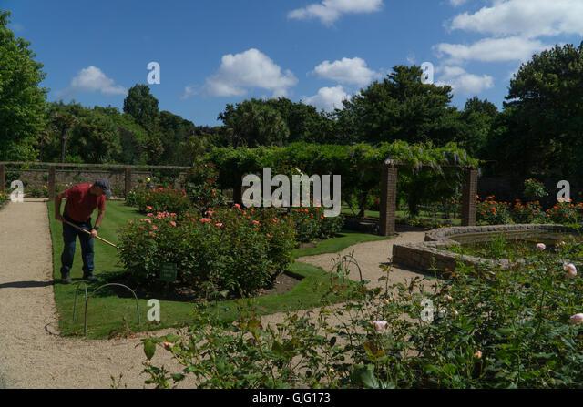 Weeding garden beds stock photos weeding garden beds for Garden design jersey channel islands