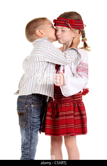 Little boy and girl kissing stock photos little boy and girl little boy kissing a little girl on the white background stock image altavistaventures Images