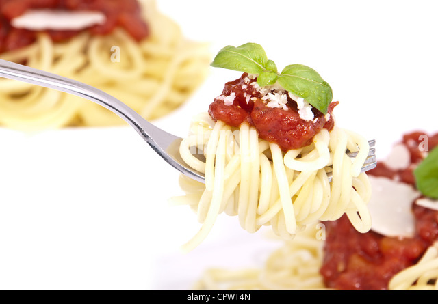 Spaghetti with tomato sauce, basil and parmesan cheese on a fork ...