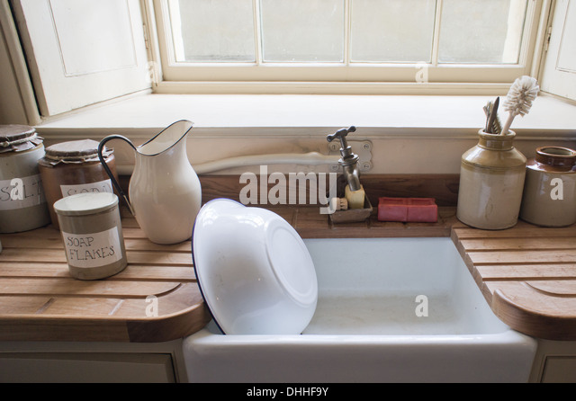 Marvelous Old Fashioned Washing Up Sink With Vintage Cannisters   Stock Image