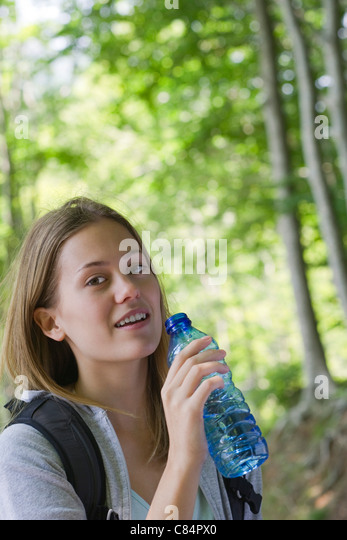 young woman drinking bottled water stock photos amp young