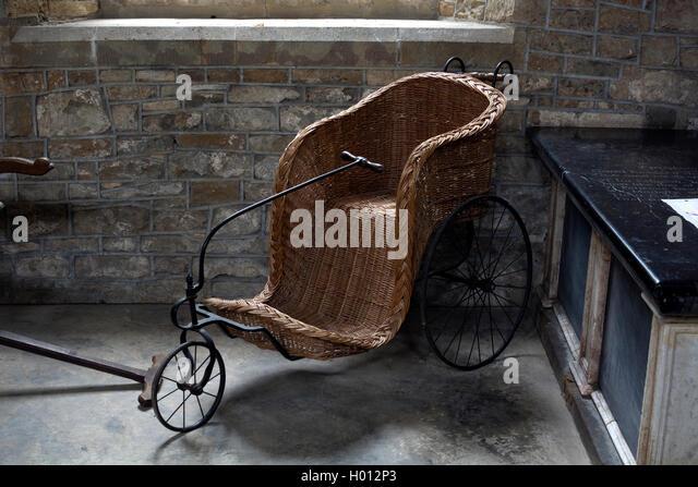 an old wicker bath chair in st georges church brailes