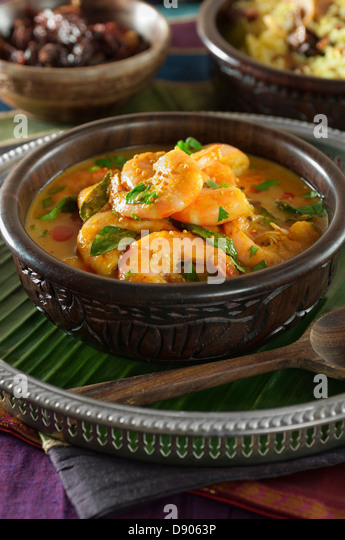 Chettinad prawn curry. Shrimp cooked with curry leaves, tamarind and ...