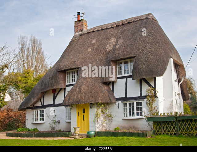 Yellow House Thatched Roof In Stock Photos & Yellow House ...