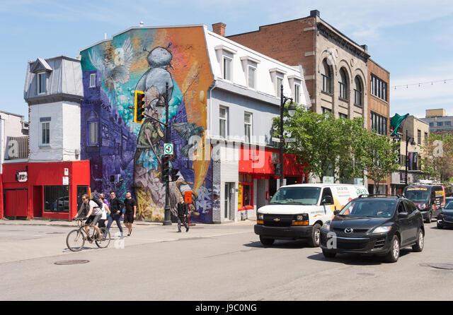 Montreal, Canada - 31 May 2017: Graffiti street art murals along Boulevard Saint-Laurent - Stock Image