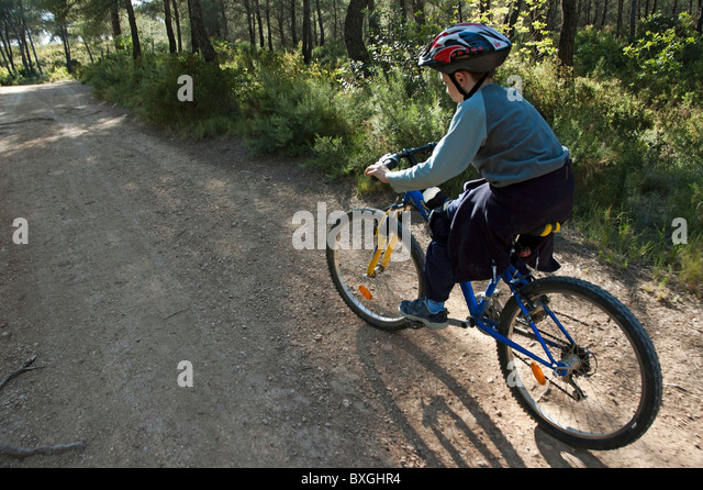 boys cycling through forest stock photos boys cycling through forest stock images alamy. Black Bedroom Furniture Sets. Home Design Ideas