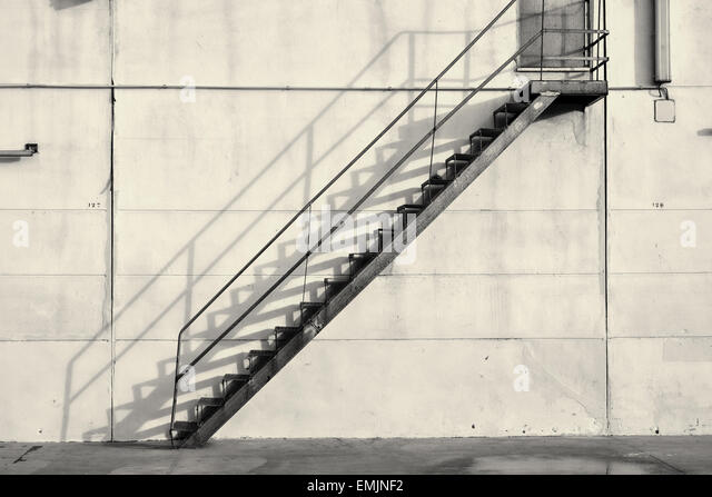 Industrial Staircase Against An Exterior Concrete Wall   Stock Image
