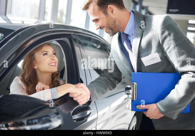 car dealer making deal female stock photos car dealer making deal female stock images alamy. Black Bedroom Furniture Sets. Home Design Ideas