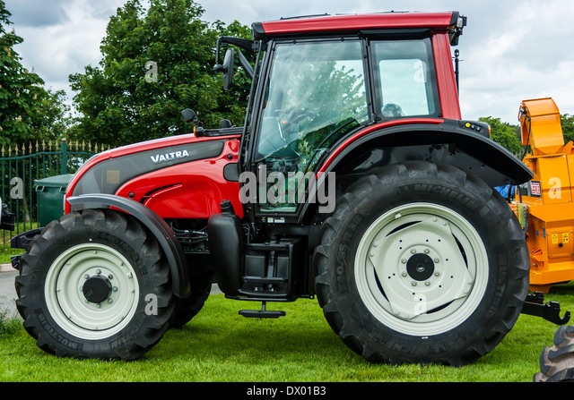 Red Brand New Farmall Tractors : Bright red tractor stock photos