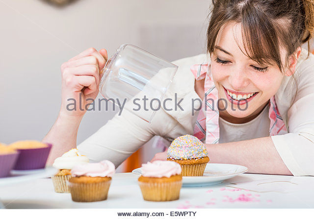 woman with her cupcakes stock image - Woman Decorating Cupcakes