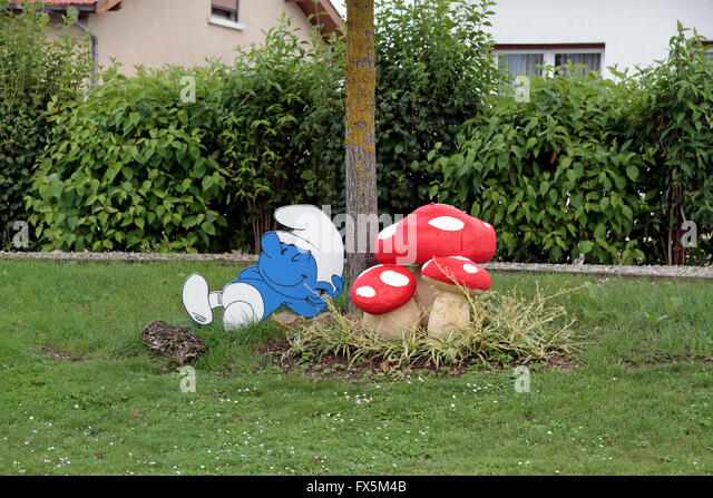 comic character smurf and mushroom inspired garden furniture in a small village near verdun