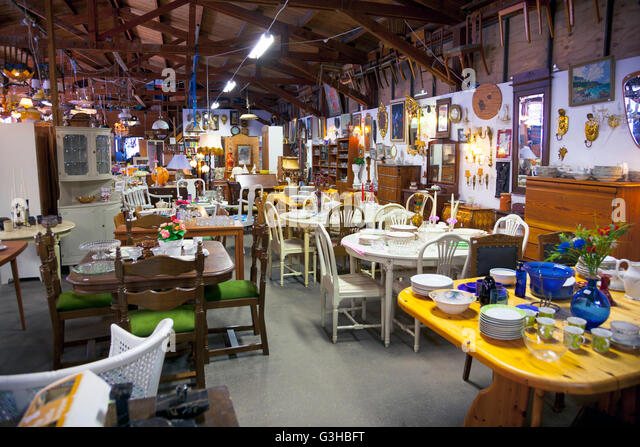 Antique second hand warehouse hall with furniture  pottery and glassware in  Sweden   Stock Image. Second Hand Furniture Stock Photos   Second Hand Furniture Stock