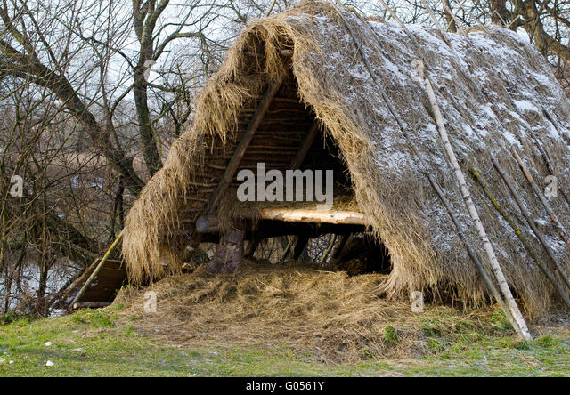 shelter of branches on the bank of the river - Stock Image & Primitive Tent Camp Stock Photos u0026 Primitive Tent Camp Stock ...