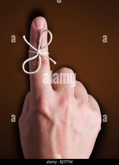 String Tied Around Ring Finger