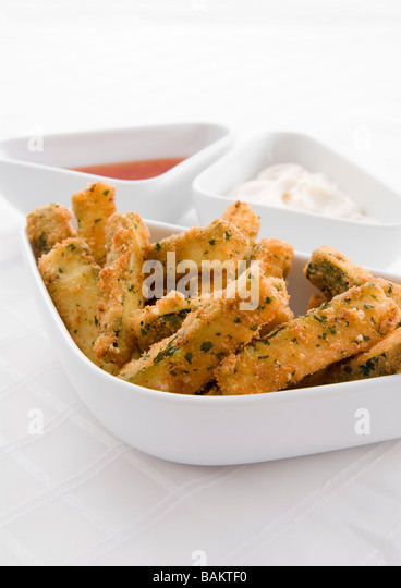 Courgette Fritters with sweet chili and mayonnaise dips - Stock Image