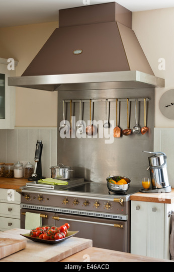Copper And Steel Kitchen Utensils Hanging From Rack Part Of A La Canche  Cooker   Stock