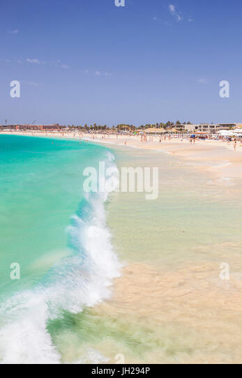 Waves breaking on the sandy beach in Santa Maria, Praia de Santa Maria, Baia de Santa Maria, Sal Island, Cape Verde, - Stock Image