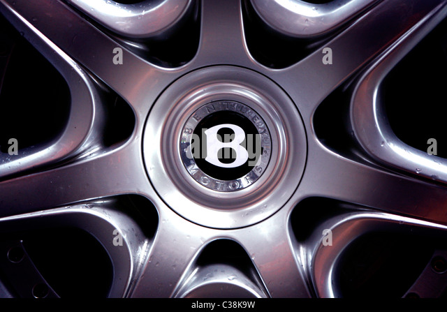 a closeup picture of a alloy wheel with the bentley branding in the