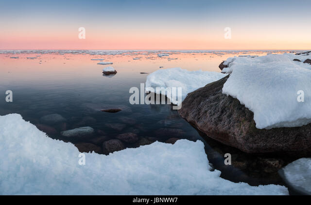 Scenic landscape with sea and sunset at winter time - Stock Image