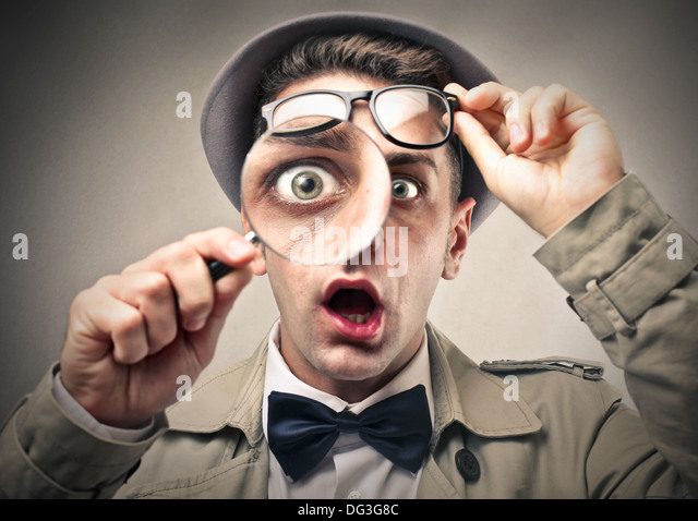 young-detective-using-a-magnifying-glass