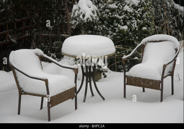 Garden Furniture Covered In Thick Snow.   Stock Image