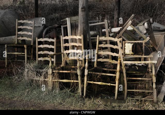 Broken Wooden Chairs In Barn