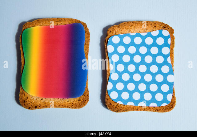 pattern impression on a rusk for breakfast blue backgroung and black shadow - Stock Image
