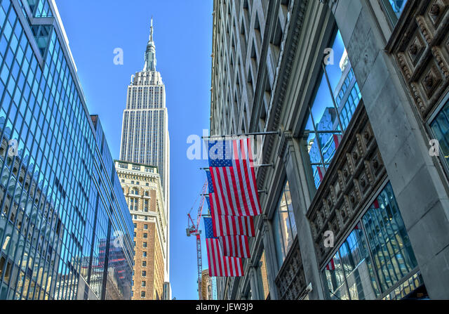 Empire State Building and US Flag - Stock Image