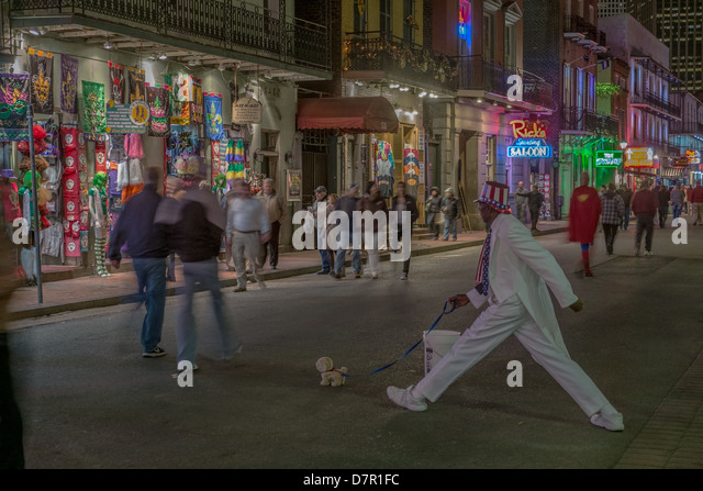A street artist poses at Bourbon street in French Quarter - Stock Image