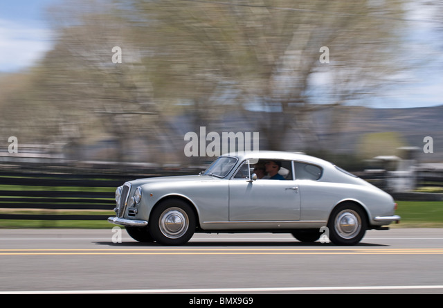 a 1956 lancia aurelia b 20s is driven in a road rally in arizona