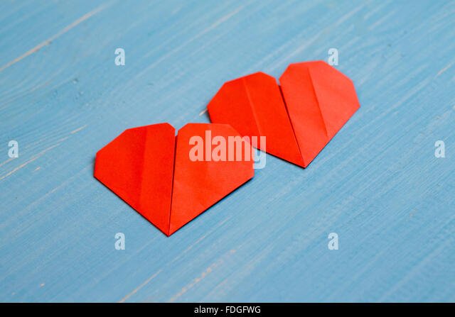 family prepared for valentines day origami of heart concept stock image