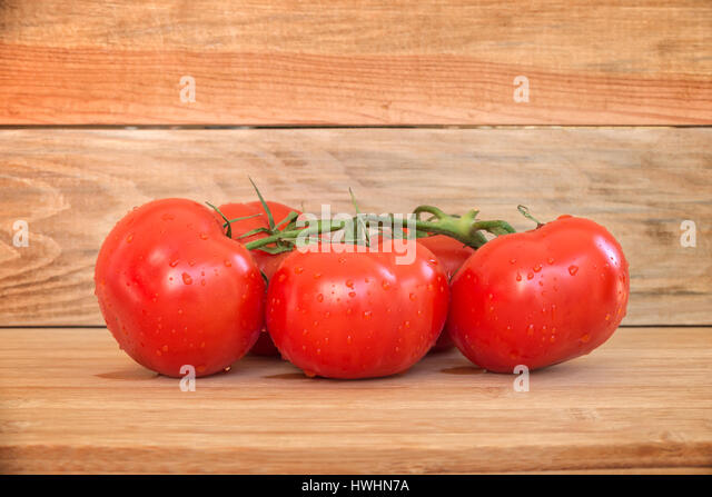 Tomatoes water droplets stock photos