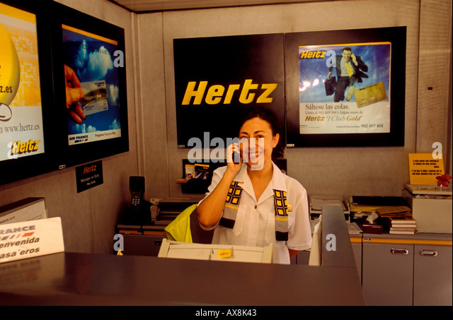 spaniard customer service agent at hertz car rental agency at barajas stock photo picture and. Black Bedroom Furniture Sets. Home Design Ideas