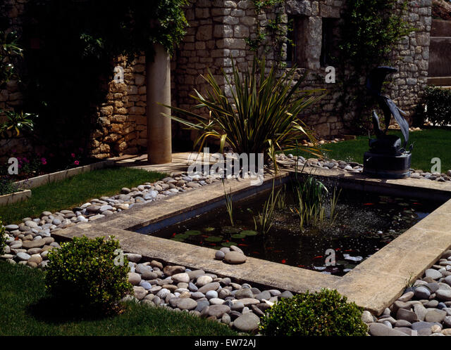 Small Rectangular Pool Edged With Pebble Paving On Patio Of French Villa    Stock Image