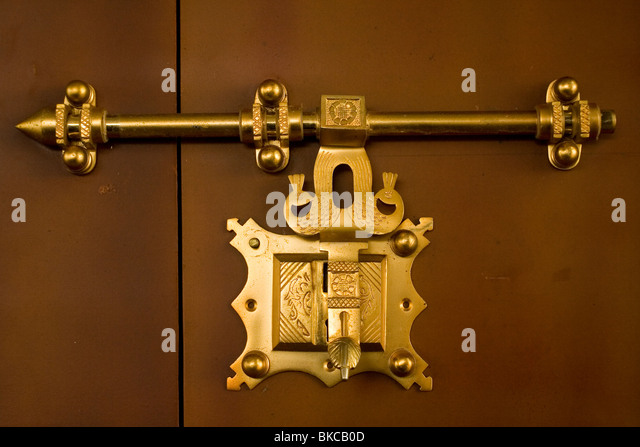 Antique traditional brass door latch and lock on wooden doors common in  kerala india locally known - Brass Door Latch On Wooden Stock Photos & Brass Door Latch On