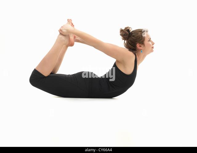 Dhanurasana stock photos dhanurasana stock images alamy for Floor yoga poses