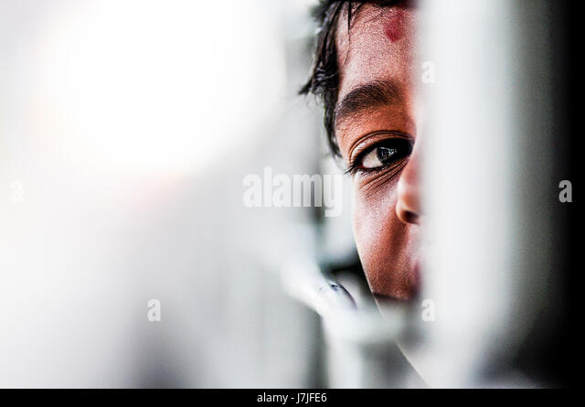 Pathankot, India, september 9, 2010: Indian kid playing hide and seek on a train in India. - Stock Image
